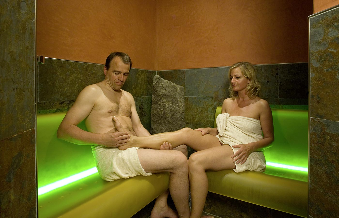 Couple enjoys the benefits of sauna at the Hotel Alpenhof